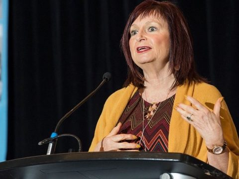 debbie speaking at a conference